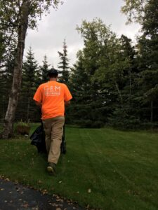 In Anchorage Lawn Maintenance worker cutting grass